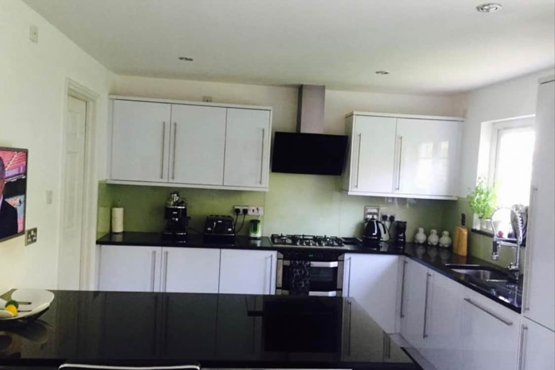 before - Modern fitted gloss kitchen